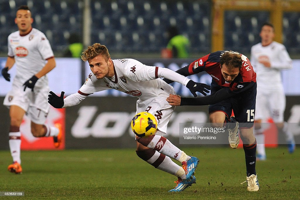 Ciro Immobile (L) of Torino FC has his shirt pulled by Giovanni Marchese of Genoa CFC during the Serie A match between Genoa CFC and Torino FC at Stadio Luigi Ferraris on November 30, 2013 in Genoa, Italy.