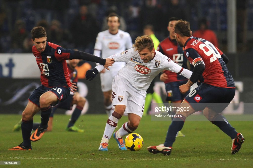 Ciro Immobile (C) of Torino FC is challenged by Sime Vrsaljko (L) of Genoa CFC during the Serie A match between Genoa CFC and Torino FC at Stadio Luigi Ferraris on November 30, 2013 in Genoa, Italy.