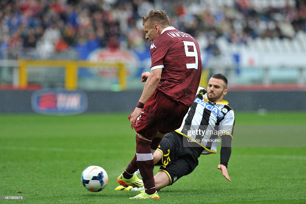 Ciro Immobile (L) of Torino FC scores their second goal during the Serie A match between Torino FC and Udinese Calcio at Stadio Olimpico di Torino on April 27, 2014 in Turin, Italy.