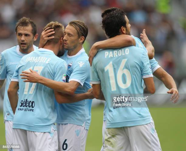 Ciro Immobile with his teammates of SS Lazio celebrates after scoring the opening goal from penalty spot during the Serie A match between SS Lazi o...
