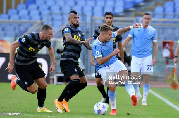 Ciro Immobileof SS Lazio compete for the ball with Arturo Vidal of FC Internazionale during the Serie A match between SS Lazio and FC Internazionale...