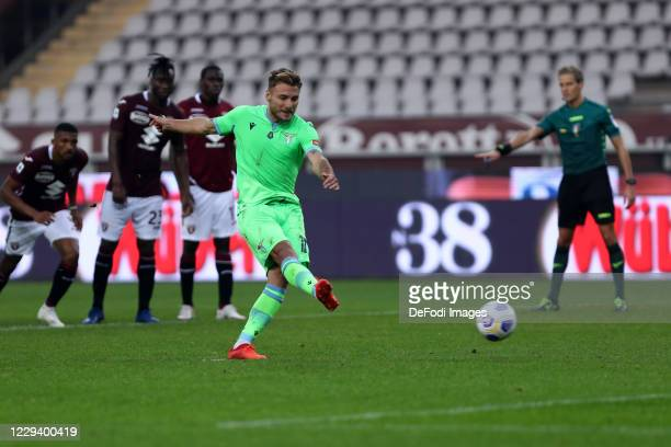 Ciro Immobileof SS Lazio scores his team's third goal during the Serie A match between Torino FC and SS Lazio at Stadio Olimpico di Torino on...