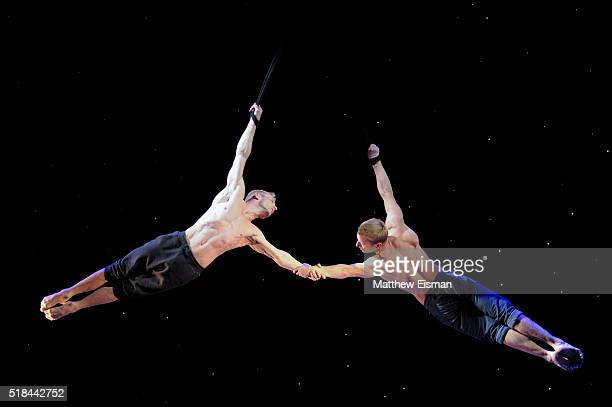 Cirque du Soleil artists Andrew Atherton and Kevin Atherton perform aerial straps during the open press rehearshal of Broadway's Paramour at the...