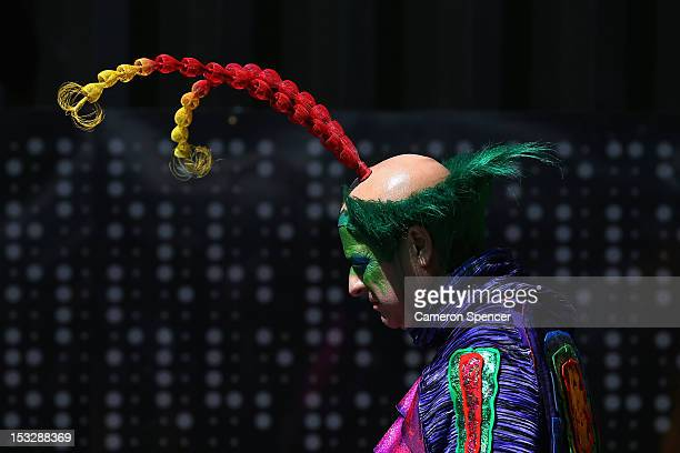 Cirque du Soleil cast member walks out of Customs House on October 3 2012 in Sydney Australia Cirque du Soleil is currently presenting 'OVO' in...