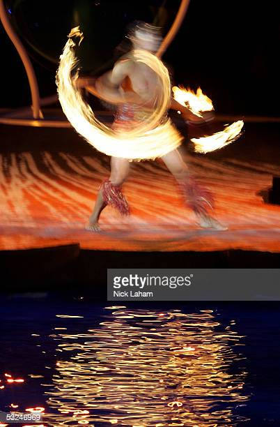 Cirque du Soleil performer Karl Sanft twirls fire during the opening ceremony for the XI FINA World Championships on July 16 2005 at the Parc...