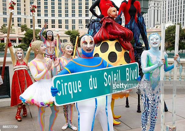 Cirque du Soleil performers including Eli Skoczylas from the show 'Mystere' wait outside the Bellagio for a Guinness World Record stilt walking...