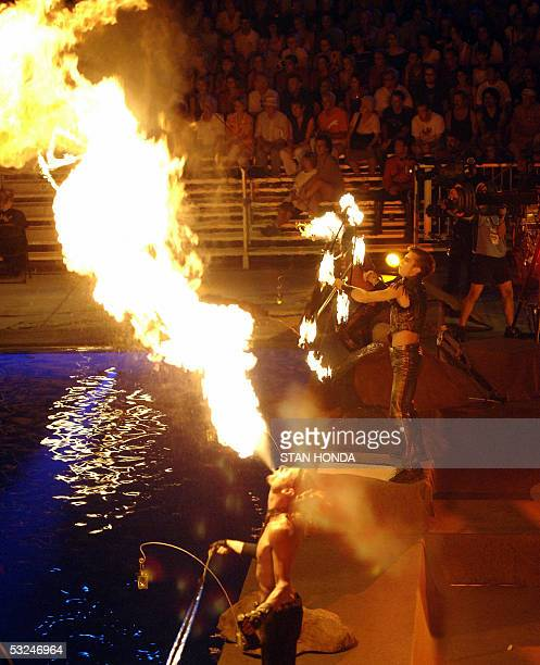 Cirque du Soleil performers use fire at the opening ceremonies 16 July 2005 for the 2005 XI FINA World Championships that will take place at the Parc...