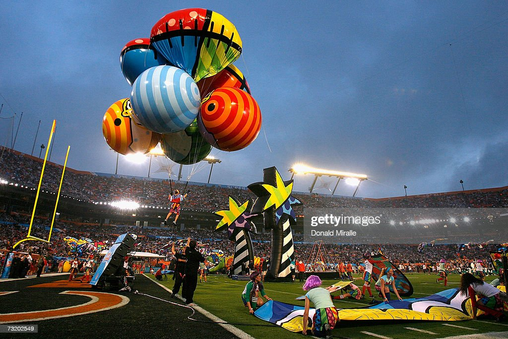 Cirque du Soleil performs in costume art designed by artist Romero Britto during pre-game & Super Bowl XLI Pre Game Entertainment Photos and Images | Getty Images