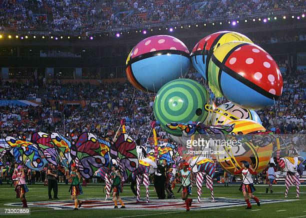 Cirque du Soleil performs in costume art designed by artist Romero Britto during pregame of Super Bowl XLI between the Indianapolis Colts and the...