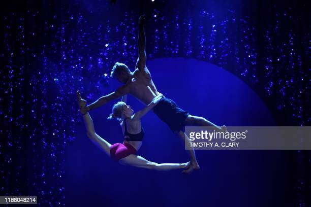 Cirque du Soleil's Nicole Faubert and Guillaume Paquin perform on the Aerial Duo Straps during a rehearsal for Twas the Night Before at the Hulu...