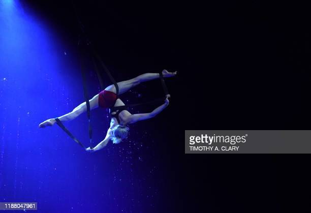 Cirque du Soleil's Nicole Faubert performs on the Aerial Duo Straps during a rehearsal for Twas the Night Before at the Hulu Theater At Madison...