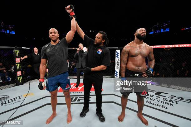 Ciryl Gane of France celebrates his submission victory over Don'Tale Mayes in their heavyweight bout during the UFC Fight Night event at Singapore...
