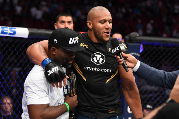 Ciryl Gane of France interacts with his coach Fernand Lopez after defeating Derrick Lewis in their interim heavyweight title bout during the UFC 265...