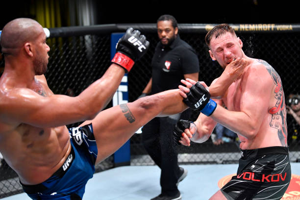 Ciryl Gane of France kicks Alexander Volkov of Russia in a heavyweight fight during the UFC Fight Night event at UFC APEX on June 26, 2021 in Las...