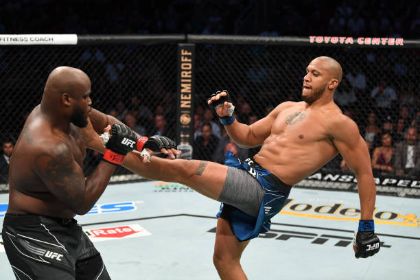 Ciryl Gane of France kicks Derrick Lewis in their interim heavyweight title bout during the UFC 265 event at Toyota Center on August 07, 2021 in...