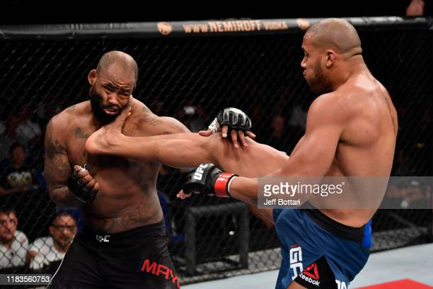 Ciryl Gane of France kicks Don'Tale Mayes in their heavyweight bout during the UFC Fight Night event at Singapore Indoor Stadium on October 26, 2019...