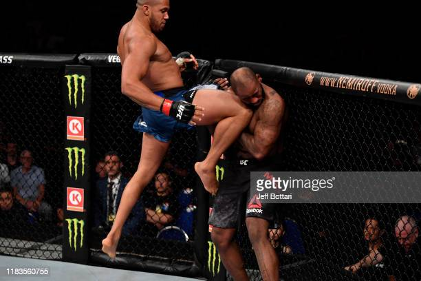 Ciryl Gane of France lands a flying knee against Don'Tale Mayes in their heavyweight bout during the UFC Fight Night event at Singapore Indoor...