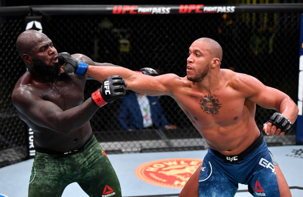 Ciryl Gane of France punches Jairzinho Rozenstruik of Suriname in a heavyweight bout during the UFC Fight Night event at UFC APEX on February 27,...