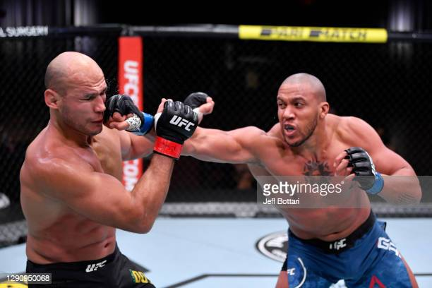 Ciryl Gane of France punches Junior Dos Santos of Brazil in their heavyweight bout during the UFC 256 event at UFC APEX on December 12, 2020 in Las...