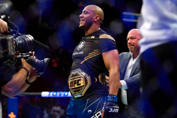 Ciryl Gane of France reacts after defeating Derrick Lewis in their interim heavyweight title bout during the UFC 265 event at Toyota Center on August...
