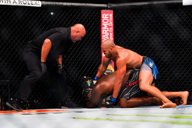 Ciryl Gane punches Derrick Lewis in the third round of their Heavyweight bout at Toyota Center on July 7, 2021 in Houston, Texas.