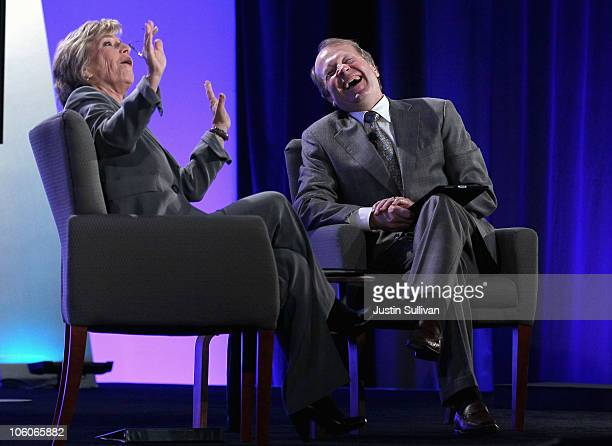 Cisco CEO John Chambers and US Sen Barbara Boxer share a laugh during a townhallstyle meeting with Cisco employees at Cisco headquarters on October...