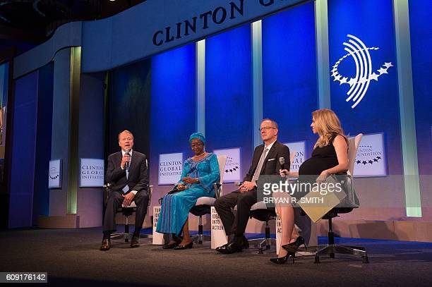 Cisco Executive Chairman John Chambers left Mayor of Monrovia Liberia Clara Doe Mvogo second from the left GSK CEO Sir Andrew Witty second from the...