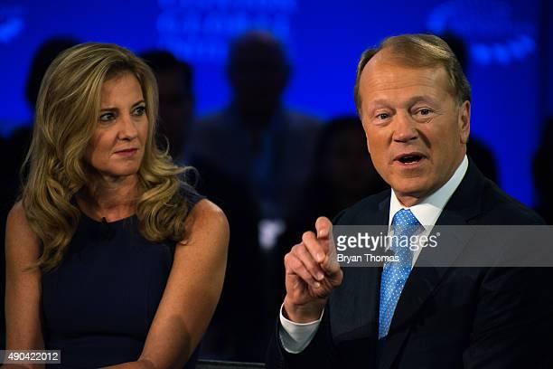 Cisco's Executive Chairman of the Board John Chambers right speaks while Box's Senior Vice President of Industry Karen Appleton left listens during...