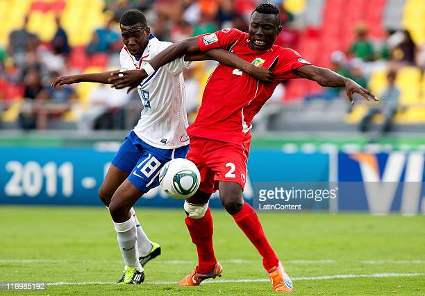Cisse Bassoumba of Congo struggles for the ball with Gyliano Vab Velzen of Holland during a match between Congo and Holland as part of the Group A of...