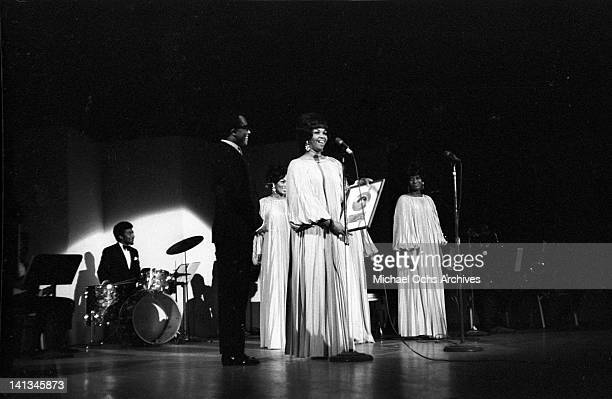 Cissy Houston and members of the vocal group 'The Sweet Inspirations' receive an award as they perform onstage on December 31 1968