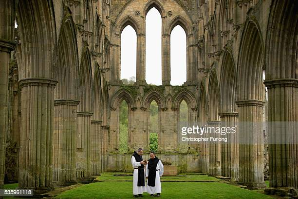 Cistercian Monks Father Joseph and Brother Bernard John read from a 500yearold prayer book as they visit the ruins of Rievaulx Abbey in North...