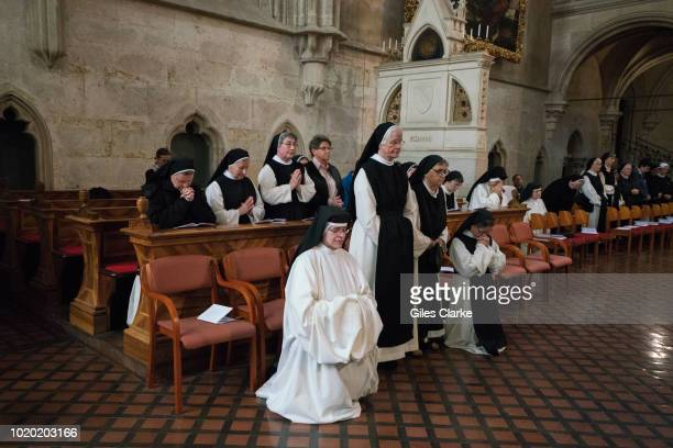 Cistercian nuns in the Abbey church at the annual meeting of the Cistercian Order in Heiligenkreuz. Heiligenkreuz Abbey is a Cistercian monastery in...