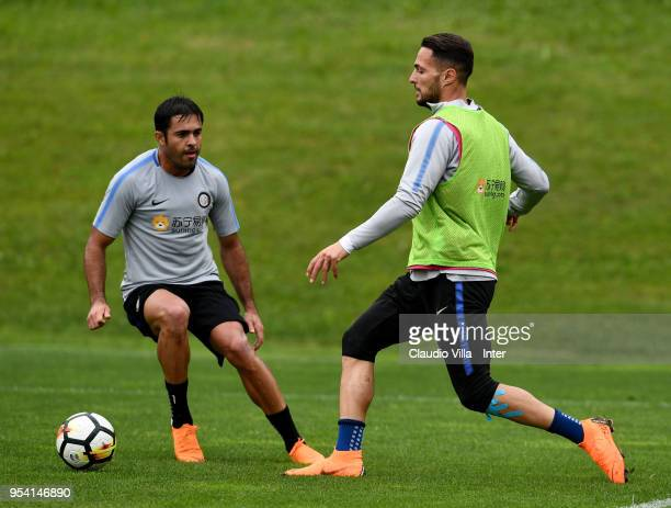 Citadin Martins Eder and Danilo D'Ambrosio of FC Internazionale compete for the ball during the FC Internazionale training session at the club's...