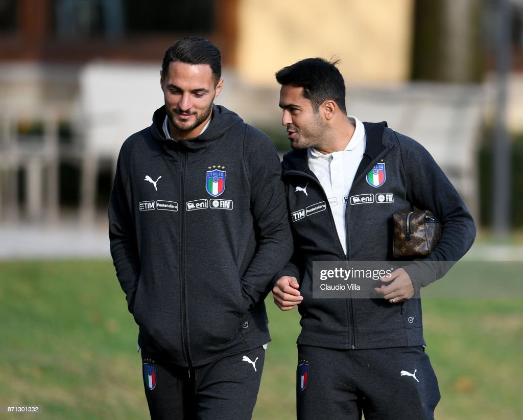 Citadin Martins Eder (R) and Danilo D'Ambrosio of Italy chat prior to the training session at Italy club's training ground at Coverciano on November 7, 2017 in Florence, Italy.