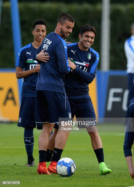 Citadin Martins Eder and Leonardo Spinazzola of Italy react during the training session at the club's training ground at Coverciano on March 25 2017...
