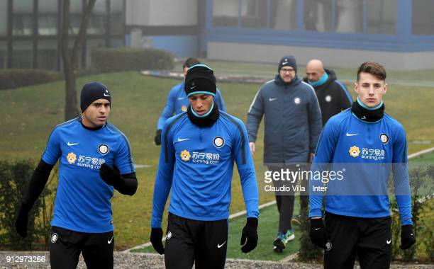 Citadin Martins Eder Joao Miranda de Souza Filho and Andrea Pinamonti of FC Internazionale chat during the FC Internazionale training session at...