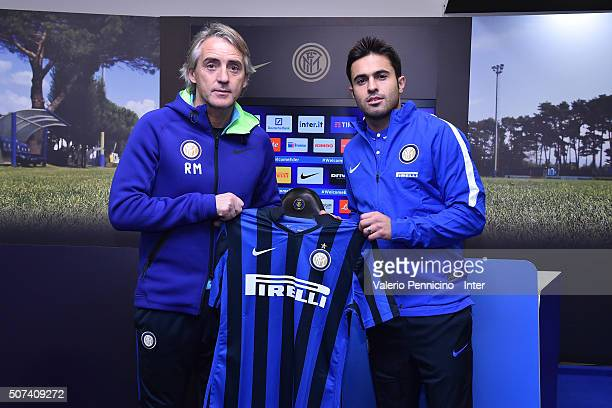 Citadin Martins Eder new signing for FC Internazionale Milano pose with the club shirt with FC Internazionale Milano head coach Roberto Mancini...