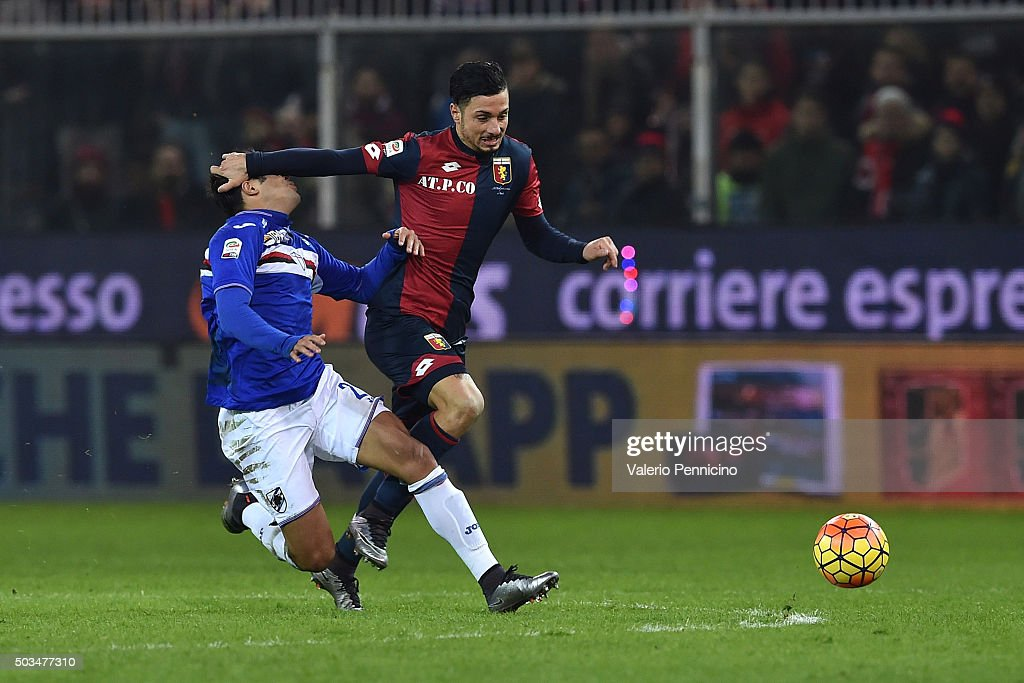 Citadin Martins Eder (L) of UC Sampdoria is tackled by Armando Izzo of Genoa CFC during the Serie A match between Genoa CFC and UC Sampdoria at Stadio Luigi Ferraris on January 5, 2016 in Genoa, Italy.