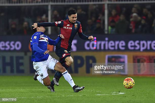 Citadin Martins Eder of UC Sampdoria is tackled by Armando Izzo of Genoa CFC during the Serie A match between Genoa CFC and UC Sampdoria at Stadio...