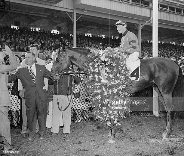 Citation with Eddie Arcaro up is in the Winner's Circle at Pimlico Racetrack May 15 after winning the Preakness Trainer Jimmy Jones holds Citation...