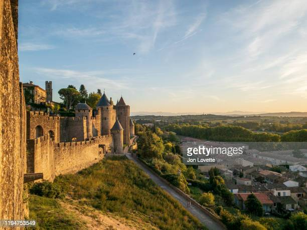 cite de carcassonne walls and modern town below - carcassonne stock pictures, royalty-free photos & images