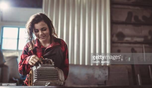 Cite girl in repair shop