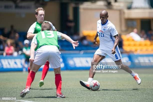 Citi All Stars' Luis Boa Morte competes with USRC's Brad Hunt , for a ball during their Masters Tournament match, part of the HKFC Citi Soccer Sevens...