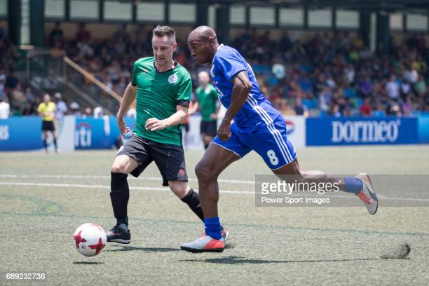 Citi All Stars' Luis Boa Morte competes with Yau Yee League Masters' Adam Bilbey for a ball during their Masters Tournament Cup Semi-Final match,...