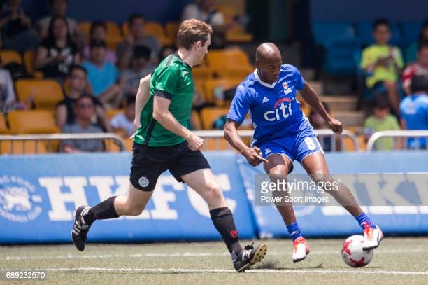 Citi All Stars's Luis Boa Morte competes with Yau Yee League Masters' Martin Rigby for a ball during their Masters Tournament Cup Semi-Final match,...