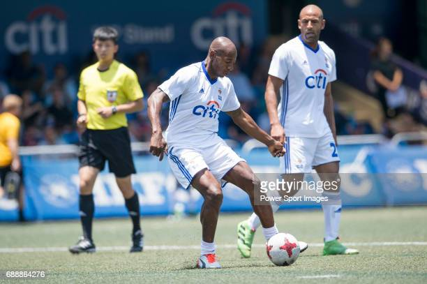 Citi All Stars's Luis Boa Morte runs the ball and competes with USRC , during their Masters Tournament match, part of the HKFC Citi Soccer Sevens...