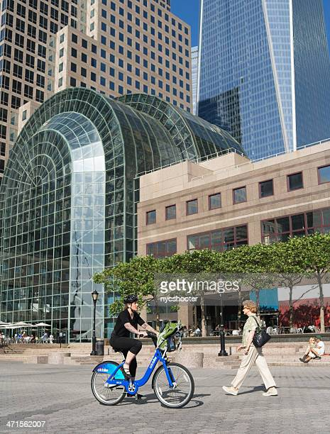 citi bike bicycle rider - world financial center new york city stock pictures, royalty-free photos & images