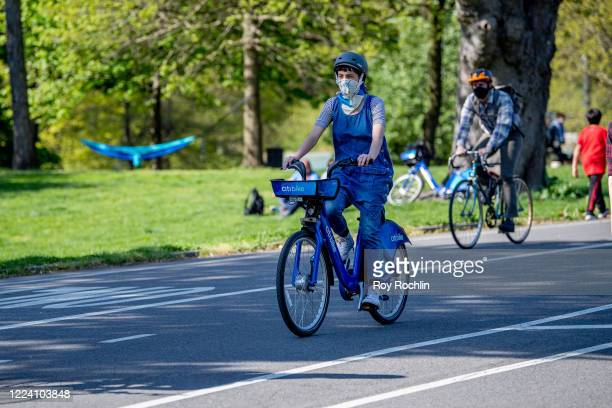 CitI Bike riders wear masks next to Prospect Park in Brooklyn during the COVID-19 outbreak on May 10, 2020 in New York City. COVID-19 has spread to...
