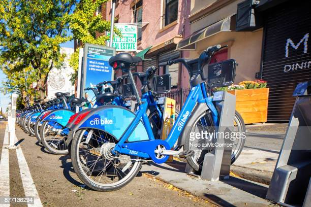 citi bike station in williamsburg brooklyn - bicycle parking station stock photos and pictures