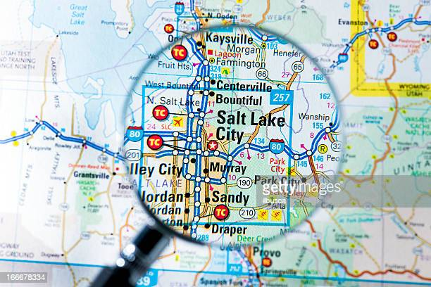 cities under magnifying glass on map: salt lake city - us state border stock photos and pictures